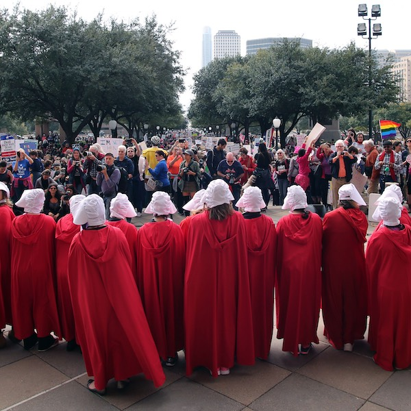 Group of women protesting dressed as characters from The Handmaids Tale