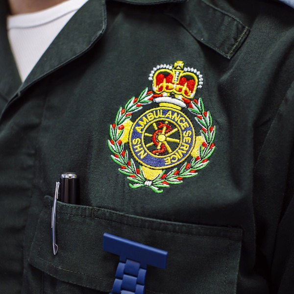 Ambulance paramedic uniform, close-up of badge
