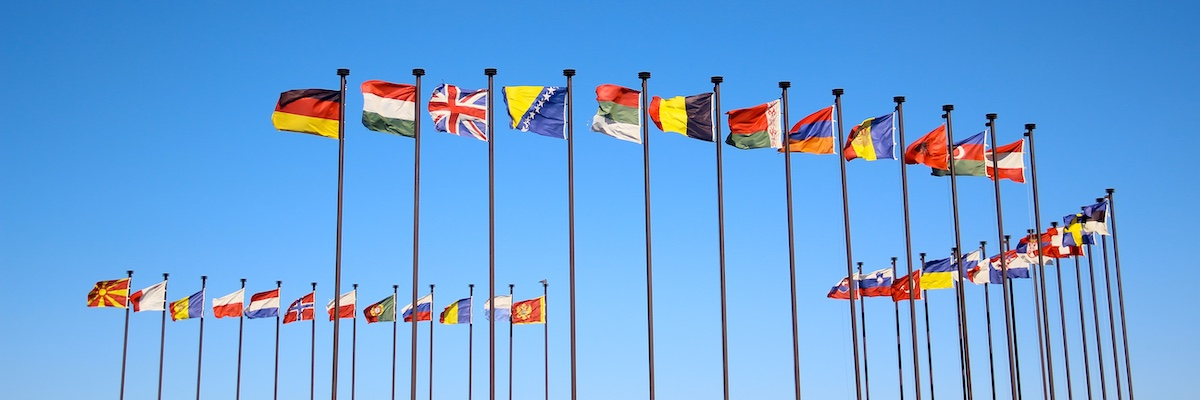 Flags of the world against blue sky
