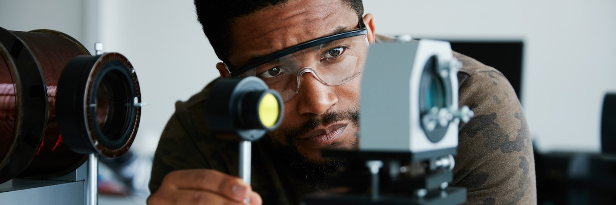 Male BAME scientist studying the Zeeman effect