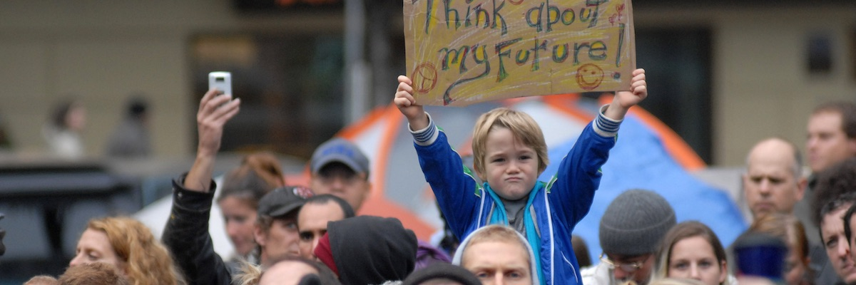 Young child holding sign at a climate change protest