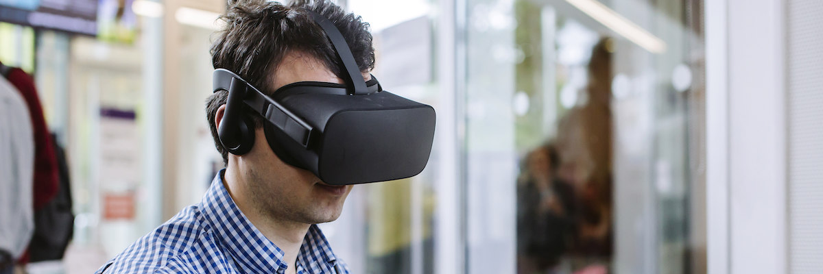 Man wearing VR headset used in healthcare
