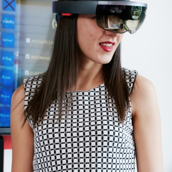 Female employee wearing virtual reality headset