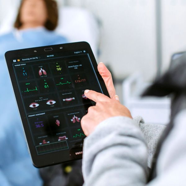 doctor studying vitals on tablet computer