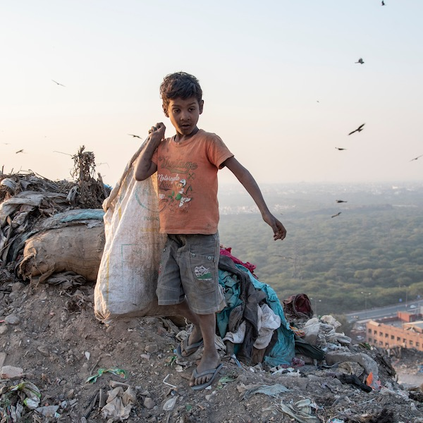 Boy in Delhi, India, collecting rubbish