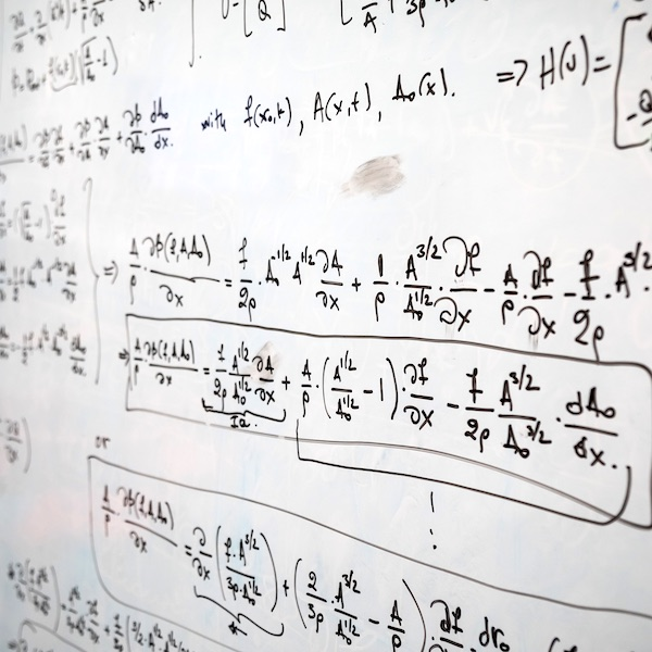 Mathematical equations on a whiteboard