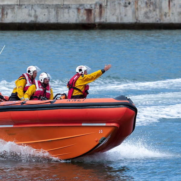 RNLI lifeboat crew in a boat on the water