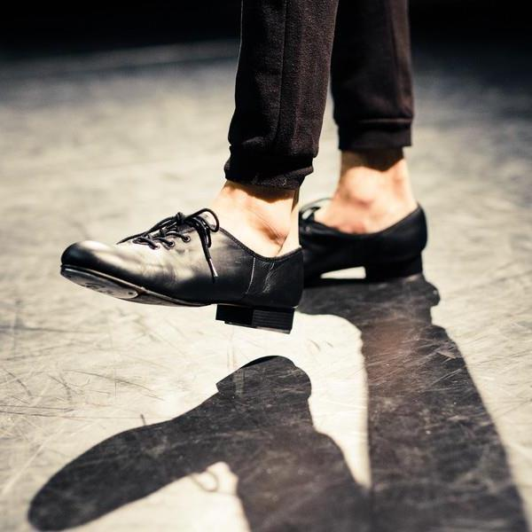 Close-up of tap dancer's shoes