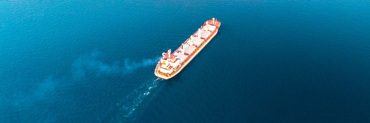 Aerial shot of a cargo ship on the ocean