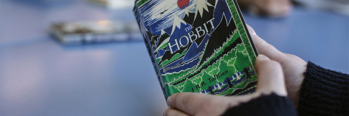 Student reading The Hobbit by J.R.R. Tolkien