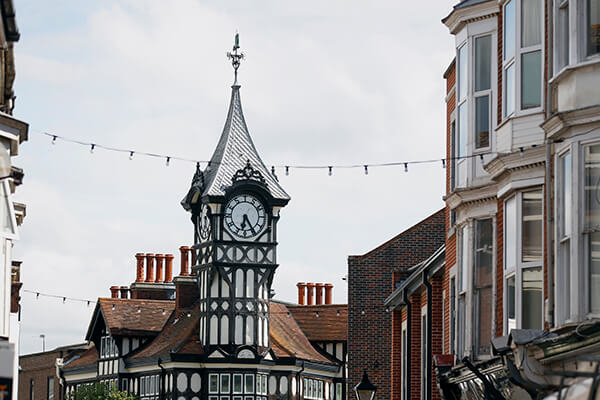 A clock atop the roof of a town house in Portsmouth
