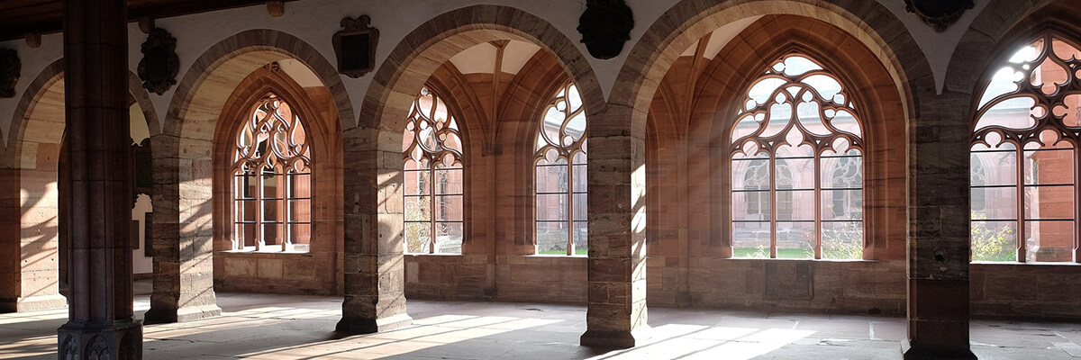 Classic interior architecture with arches, pillars and sunlit windows