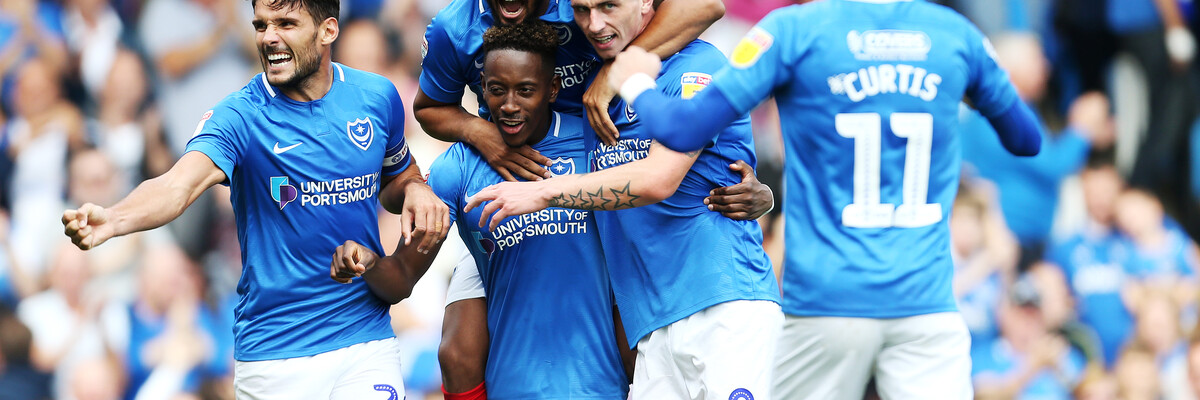 Portsmouth FC celebrate a goal in University of Portsmouth-sponsored kit