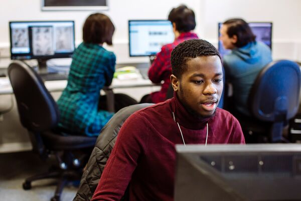 Black male student at computer