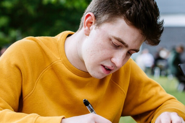 Male student studying outside