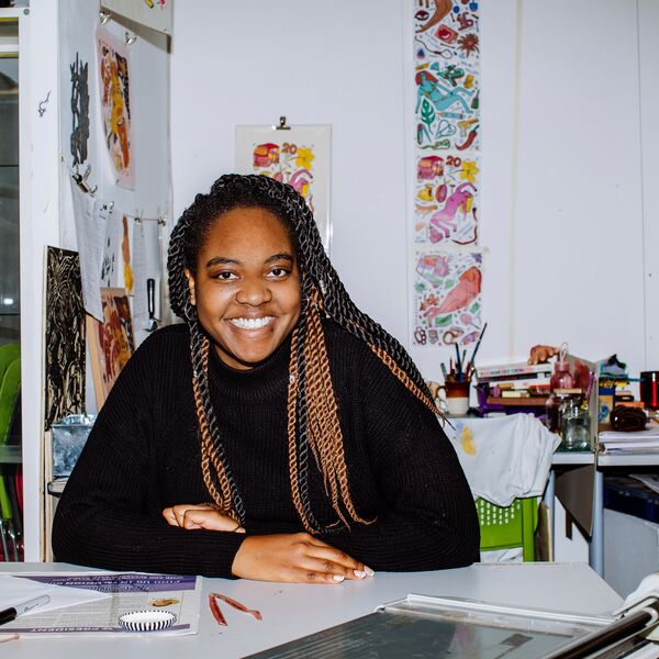 Female illustration student smiling in workshop