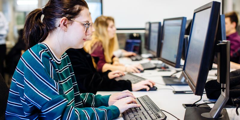 Female student studying in computer suite