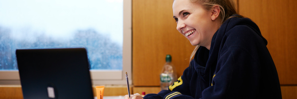 Female student smiling in the library