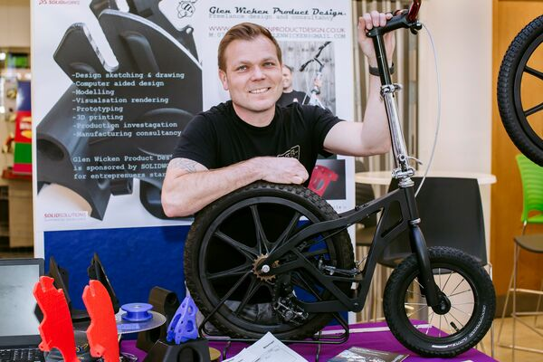Glen Wicken showing off his electric step bike at the enterprise showcase