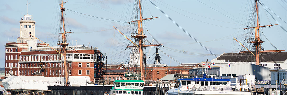 HMS warrior and gosport ferry docked in portsmouth