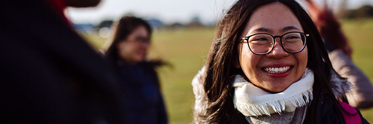 a female student from hong kong smiling on southsea common
