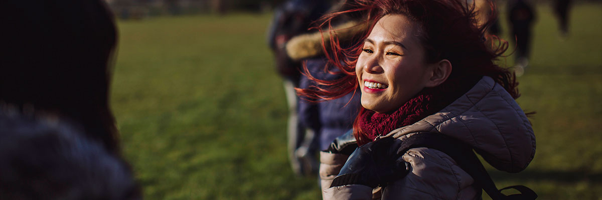 a female student from Laos smiling on Southsea common