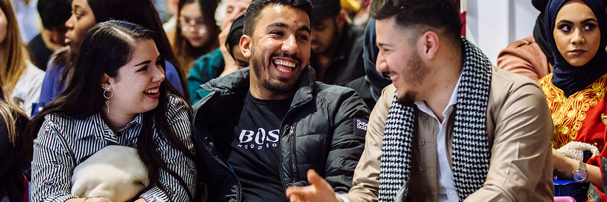 a male student from Libya laughing at a festival of cultures