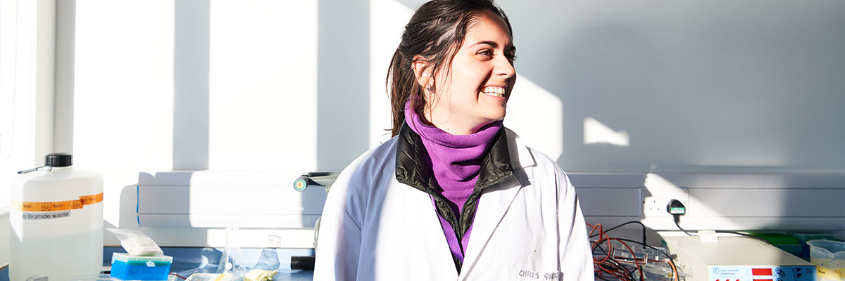 smiling female romanian student in a lab