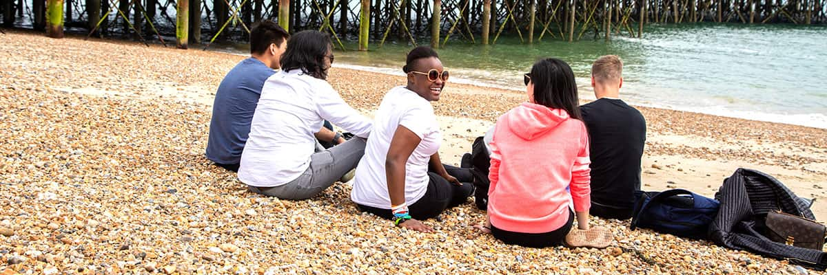 Summer school students on Portsmouth beach
