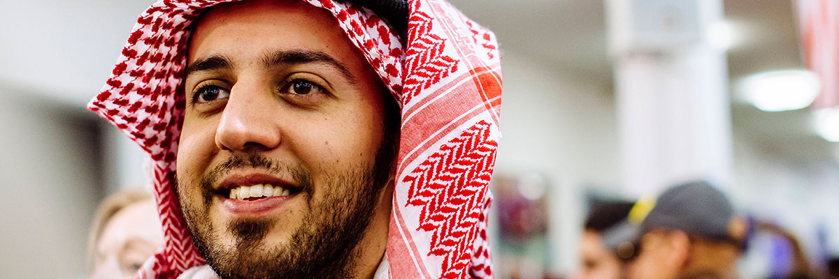 a male student from UAE at a festival of culture