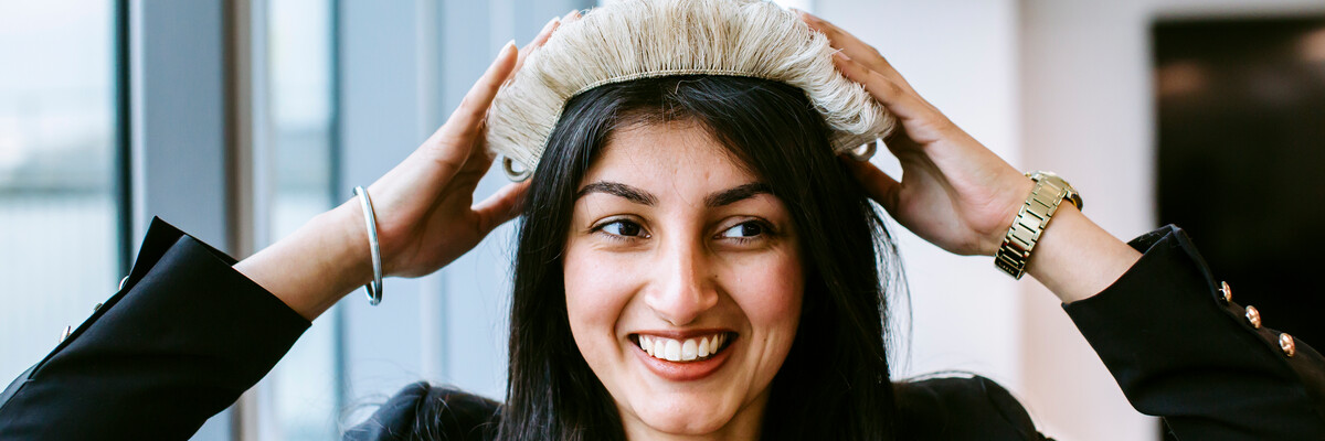 female student wearing barrister's wig