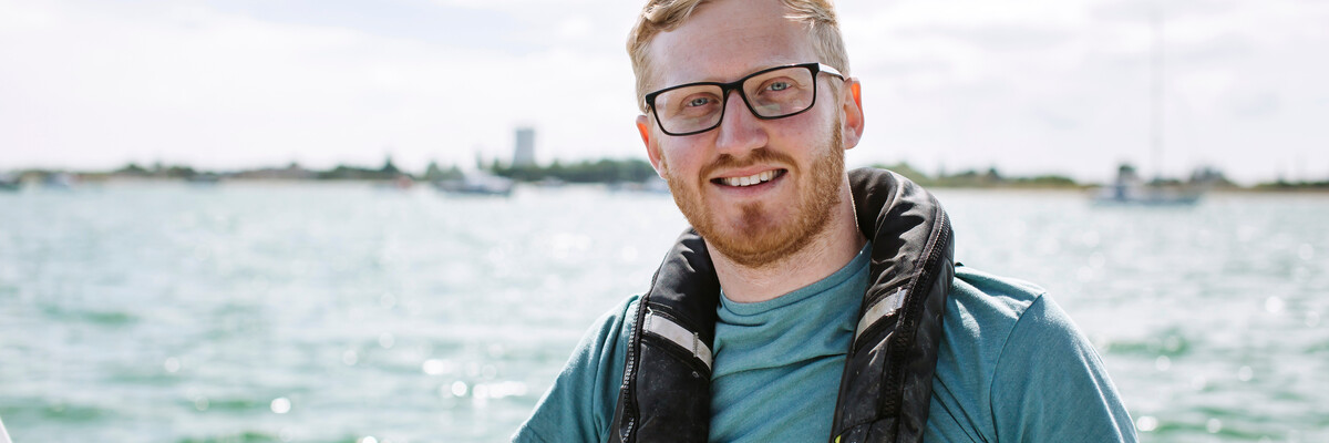 Male University of Portsmouth PhD candidate on boat