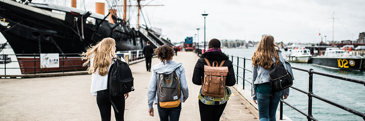 Students walk toward historical ship