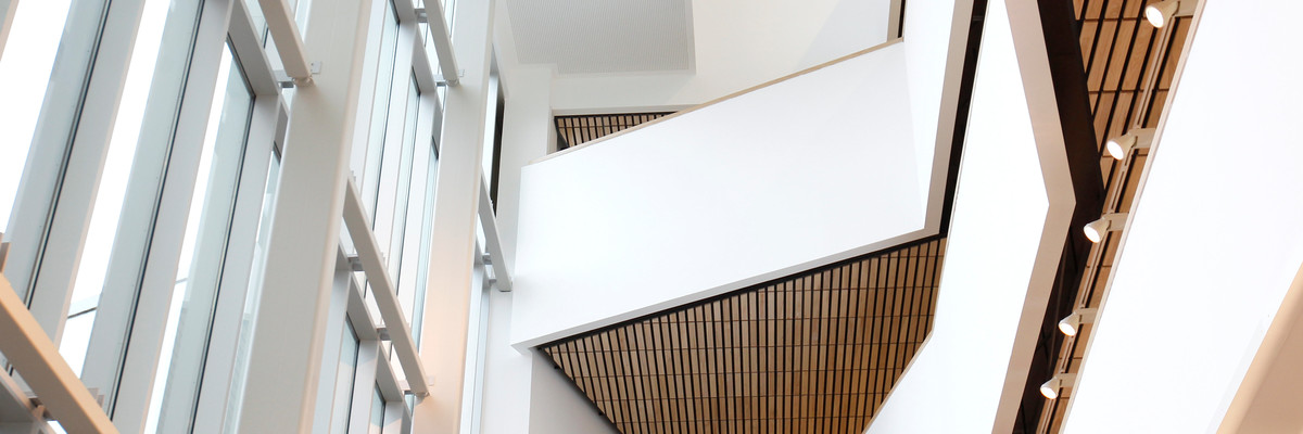 Staircase in Eldon Building, showing white walls and wooden slats
