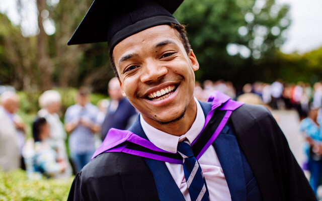 Male University of Portsmouth student at graduation ceremony
