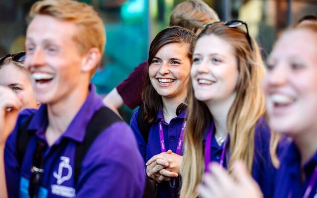 University of Portsmouth alumni in purple t-shirts