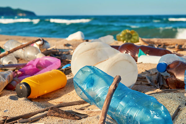 Stock image of plastic waste on a sunny beach