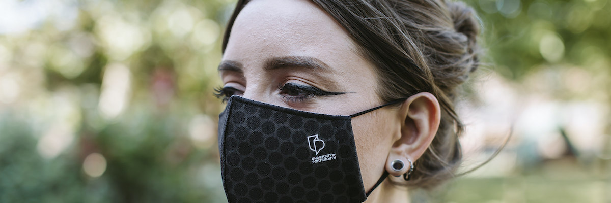 Female UoP student wearing a mask