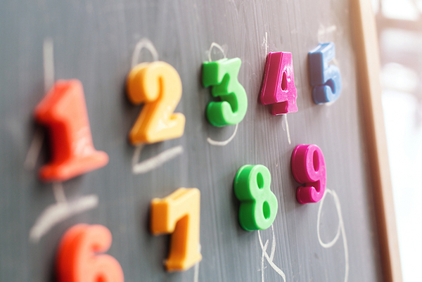 Colourful magnetic numbers on blackboard