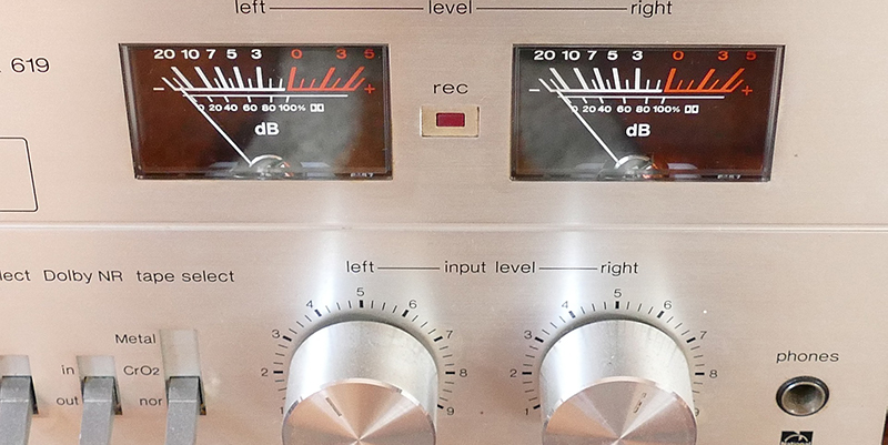 Front of a stereo with gauges and volume controls