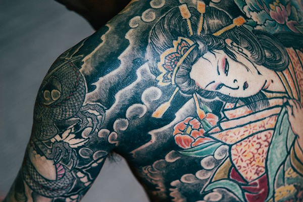 Traditional Japanese tattoo on a man's back and arm
