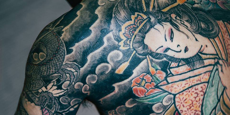 Traditional Japanese tattoo on a man's back and shoulder