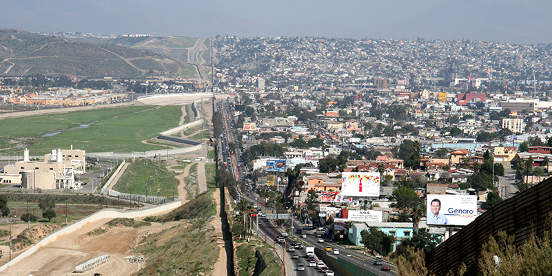 Wide shot of the US and Mexico border