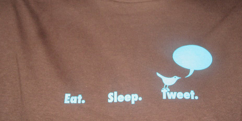 "Black shirt reading ""eat. sleep. tweet."""