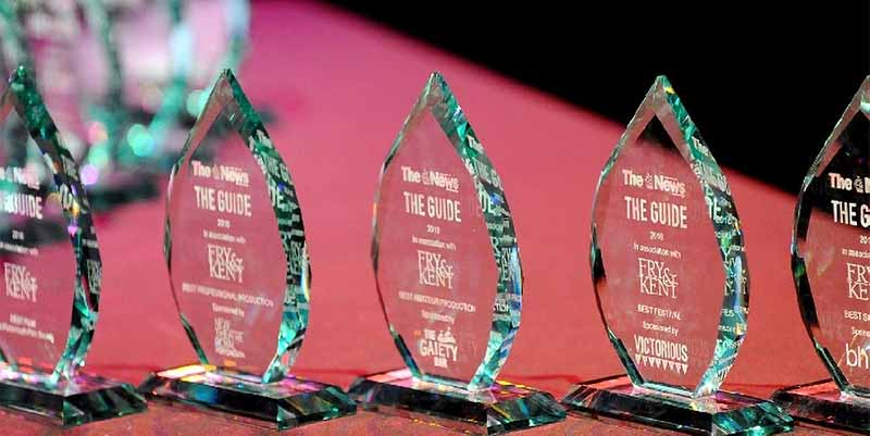 Guide Awards lined up on red table at the 2019 event