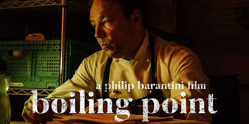 "Lead actor for the Boiling Point film, Stephen Graham, looks off camera with the words ""boiling point"" in front"