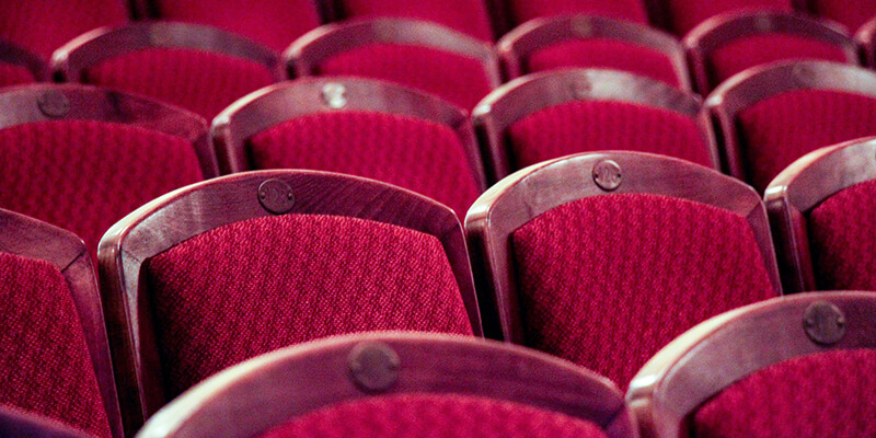 Rows of red theatre chairs