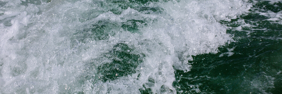 Close up of wave crashing in the sea