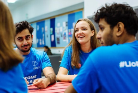 four-students-who-are-university-of-portsmouth-welcome-ambassadors-sitting-at-a-table-chatting
