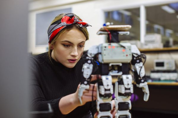 Female engineer working with robot